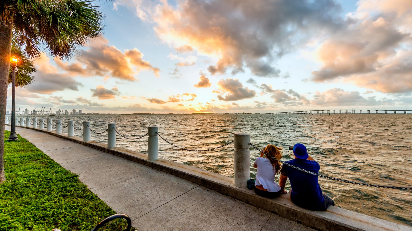 couple sitting by miami harbor