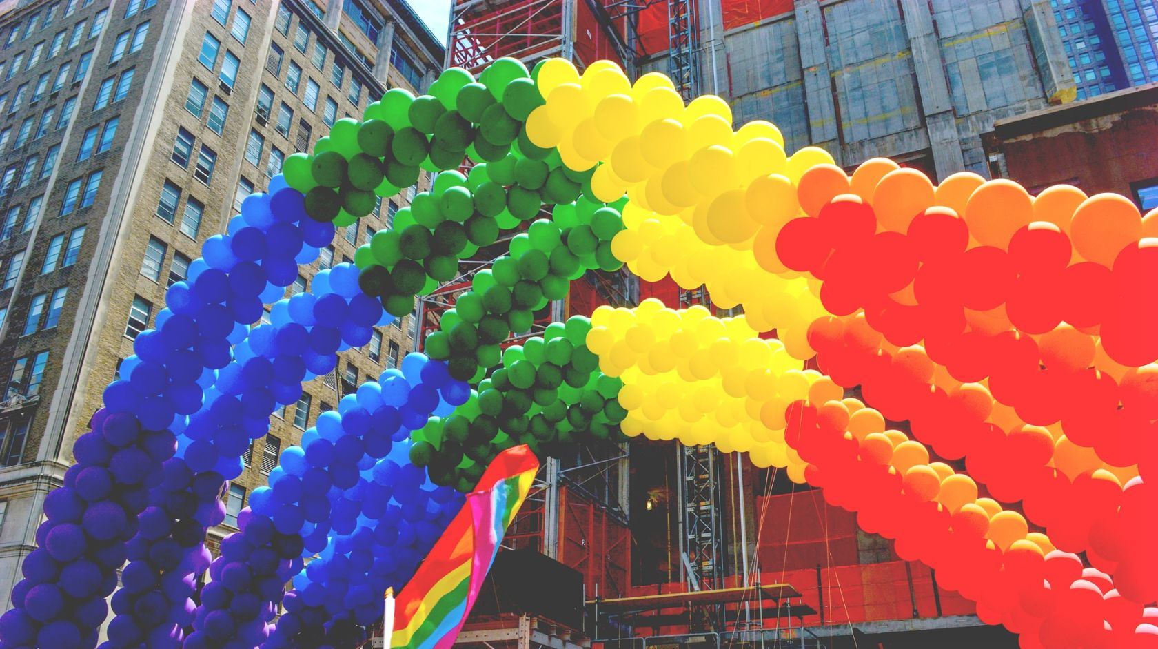 Colorful balloons making up the gay flag
