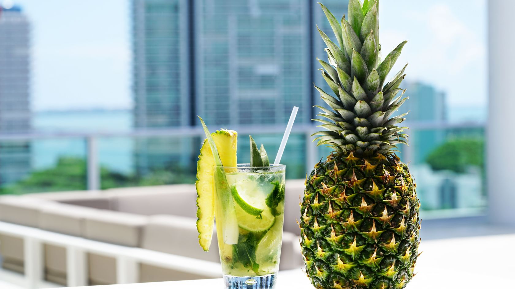 pineapple cocktail drink with pineapple next to it on Novotel Miami Brickell hotel rooftop